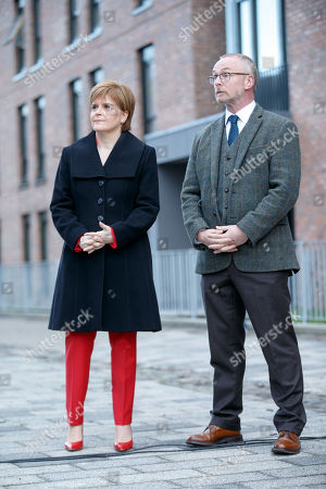 Scotlands First Minister and SNP Leader Nicola Sturgeon alongside artist Andy Scott (R) at the unveiling of the Charles Rennie Mackintosh statue in Glasgow, Scotland, 10 December 2018. The work by Andy Scott is believed to be the world's first public sculpture celebrating Scottish architect, designer, and artist. Mackintosh and will be unveiled on the 90th anniversary of his death. Reports state that Nicola Sturgeon has called on Jeremy Corbyn to lodge a motion of no confidence in the Prime Minister after the British Priome Minister Theresa May's Meaningful Vote on her Brexit deal was shelved.