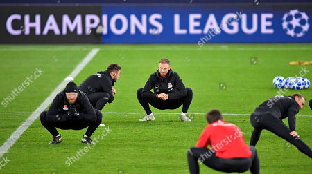Moscow defender Benedikt Hoewedes, center, stretches during a training session prior the Champions League group D soccer match between FC Schalke 04 and Lokomotiv Moscow in Gelsenkirchen, Germany
