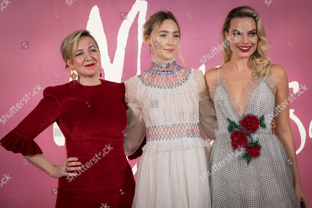 Josie Rourke, Saoirse Ronan, Margot Robbie. Director Josie Rourke, from left, actresses Saoirse Ronan and Margot Robbie pose for photographers upon arrival at the premiere of the film 'Mary Queen of Scots', in London