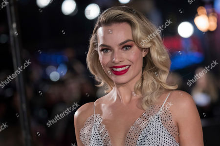 Margot Robbie poses for photographers upon arrival at the premiere of the film 'Mary Queen of Scots', in London