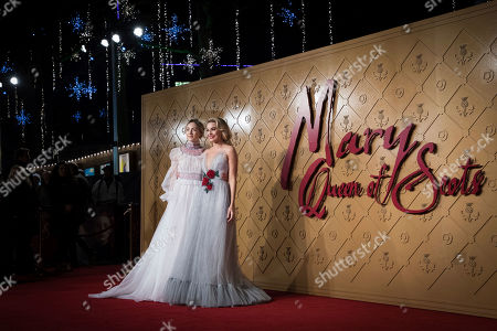 Saoirse Ronan, Margot Robie. Actresses Saoirse Ronan, left, and Margot Robbie pose for photographers upon arrival at the premiere of the film 'Mary Queen of Scots', in London