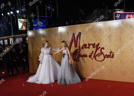 Margot Robbie (R) and Irish actress, Saoirse Ronan arrive at the European premiere of 'Mary Queen of Scots' in Leicester square in London, Britain, 10 December 2018.