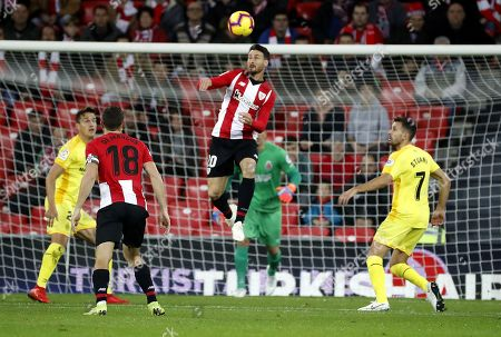 Athletic Bilbao's Aritz Aduriz (C) in action against Girona's Christian Stuani (R) during a Spanish La Liga soccer match between Athletic Bilbao and Girona at San Mames stadium in Bilbao, northern Spain, 10 December 2018.