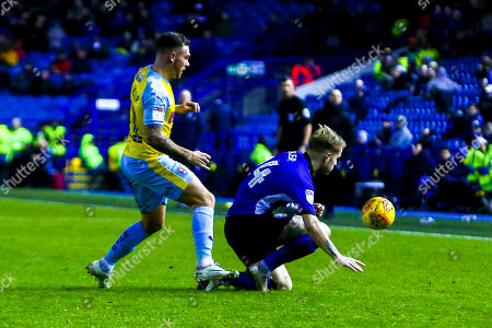 Stock Photo of Ashley Baker of Sheffield Wednesday is tripped by Jon Taylor of Rotherham United