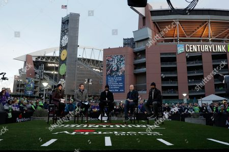 Monday football broadcasters Suzy Kolber, left, Steve Young, Randy Moss, Matt Hasselbeck and Charles Woodson appear before an NFL football game between the Seattle Seahawks and the Minnesota Vikings, in Seattle