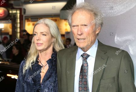 """Christina Sandera, Clint Eastwood. Christina Sandera, left, and director/actor Clint Eastwood arrive at the world premiere of """"The Mule"""", at the Westwood Regency Village Theatre in Los Angeles"""
