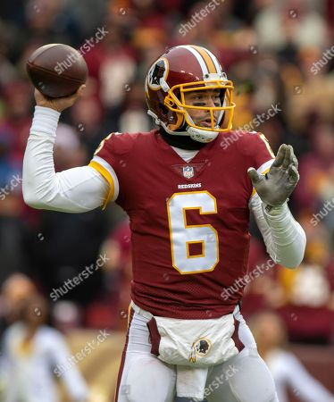 Washington Redskins quarterback Mark Sanchez (6) looks for a receiver in first quarter action during the game against the New York Giants at FedEx Field in Landover, Maryland. The Giants won the game 40 - 16.