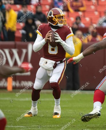 Washington Redskins quarterback Mark Sanchez (6) looks for a receiver in the first quarter against the New York Giants at FedEx Field in Landover, Maryland.