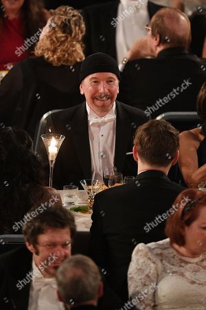 Stock Photo of David Howell Evans ' The Edge ' from the U2 group attends the Nobel Prize Banquet 2018 at City Hall