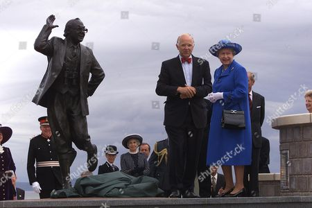 Queen Elizabeth II Unveils A Bronze Statue Of Comedian Eric Morecambe On The Promenade At Morecambe July 23. Morecambe Who Died In 1984 Remains A Household Name For His Comic Partnership With Ernie Wise.