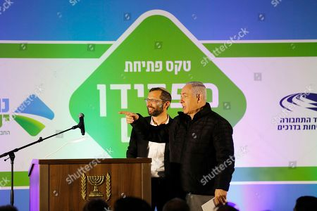Israeli Prime Minister Benjamin Netanyahu (R) and Head of the Binyamin Regional Council Israel Ganz (L) during the inauguration ceremony of a new interchange in the Israeli settlement of Adam, located a few kilometers outside Jerusalem, near the West Bank city of Ramallah, 11 December 2018.