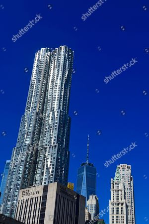 New York by Gehry, high-rise by architect Frank Gehry, 8 Spruce Street, and the top of the Woolworth high-rise building, One World Trade Center, Manhattan, New York, USA, America