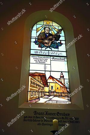 Stock Image of Lead glass window in honour of Xaver Gruber, composer of the Christmas carol Silent Night, Holy Night, Saint Nicholas, Oberndorf, Salzburg Lake District, Austria