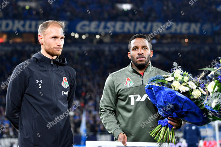 Former Schalke players Jefferson Farfan, right, and Benedikt Hoewedes receive flowers prior to the Champions League group D soccer match between FC Schalke 04 and Lokomotiv Moscow in Gelsenkirchen, Germany