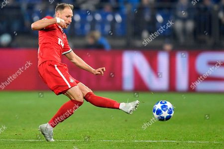 Moscow's Benedikt Hoewedes kicks the ball during the Champions League group D soccer match between FC Schalke 04 and Lokomotiv Moscow in Gelsenkirchen, Germany
