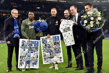 Former Schalke players Jefferson Farfan, 2nd left, and Benedikt Hoewedes, 3rd left, receive flowers prior to the Champions League group D soccer match between FC Schalke 04 and Lokomotiv Moscow in Gelsenkirchen, Germany