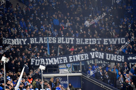 Schalke supporters celebrate former player Benedikt Hoewedes prior to the Champions League group D soccer match between FC Schalke 04 and Lokomotiv Moscow in Gelsenkirchen, Germany