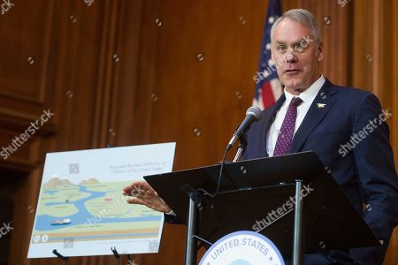 Stock Picture of Secretary of the Interior Ryan Zinke speaks after an order withdrawing federal protections for countless waterways and wetland was signed, at EPA headquarters in Washington