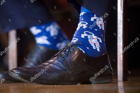 Secretary of the Interior Ryan Zinke wears astronaut socks during an order signing ceremony withdrawing federal protections for countless waterways and wetlands at Environmental Protection Agency headquarters in Washington