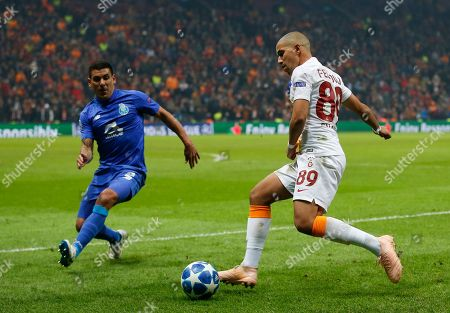 Galatasaray midfielder Sofiane Feghouli, right, fights for the ball with Porto defender Maxi Pereira during the Champions League Group D soccer match between Galatasaray and Porto in Istanbul