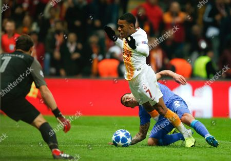 Stock Photo of Porto defender Maxi Pereira, right, polls Galatasaray forward Garry Rodrigues during the Champions League Group D soccer match between Galatasaray and Porto in Istanbul