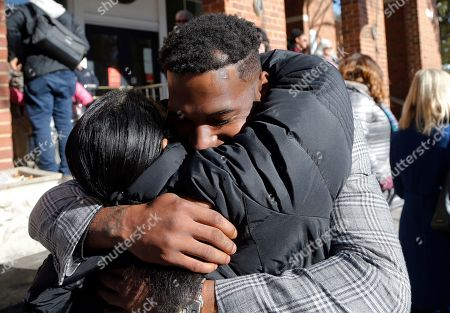 Marcus Martin, who was injured during the 2017 car attack, hugs a supporter after a jury recommended life plus 419 years for James Alex Fields Jr. for the death of Heather Heyer as well as several other charges related to the Unite the Right rally in 2017 in Charlottesville, Va
