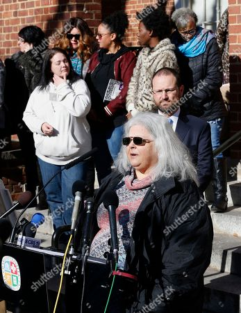 Susan Bro, front, mother of Heather Heyer, talks to the media in front of Charlottesville Circuit Court after a jury recommended life plus 419 years for James Alex Fields Jr. for the death of Heyer as well as several other charges related to the Unite the Right rally in 2017 in Charlottesville, Va., . Other victims of Fields attack are in the background