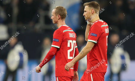 Lokomotiv's Vladislav Ignatyev and Lokomotiv's Benedikt Hoewedes react after the UEFA Champions League Group D soccer match between Schalke 04 and Lokomotiv Moscow in Gelsenkirchen, Germany, 11 December 2018.