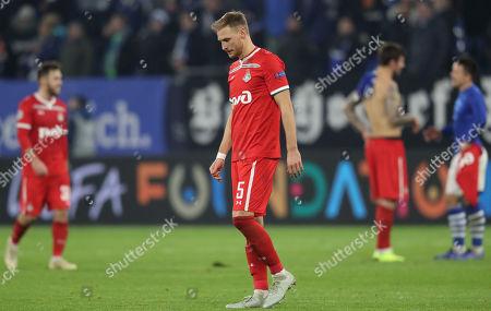 Lokomotiv's Benedikt Hoewedes reacts after the UEFA Champions League Group D soccer match between Schalke 04 and Lokomotiv Moscow in Gelsenkirchen, Germany, 11 December 2018.
