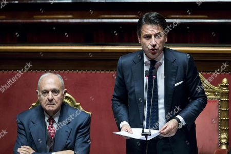 Italy's Prime Minister Giuseppe Conte speaks at the Senate next to the Minister for European Affairs Paolo Savona (L) prior to the upcoming European Council meeting on Brexit in Brussels, in Rome, Italy, 11 December 2018.