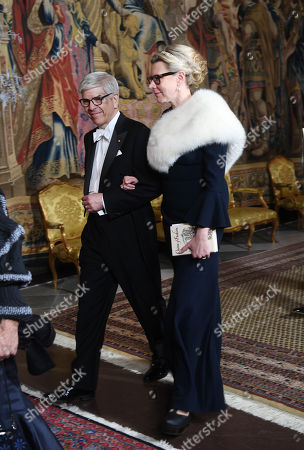Economic Sciences laureate Paul M. Romer (L) and his wife Professor Caroline Weber arrive for the King's dinner for the Nobel Laureates at the Royal Palace in Stockholm, Sweden, 11 December 2018.