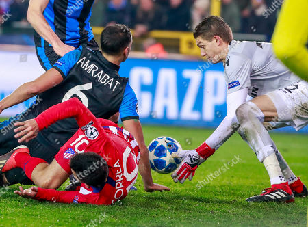 (L-R) Sofyan Amrabat of Club Brugge KV , Angel Correa of Atletico Madrid and goalkeeper Ethan Horvath of Club Brugge KV  fight for the ball during the UEFA Champions League soccer match between Club Brugge KV and Atletico Madrid at the Jan Breydel Stadium in Bruges, Belgium, 11 December 2018.