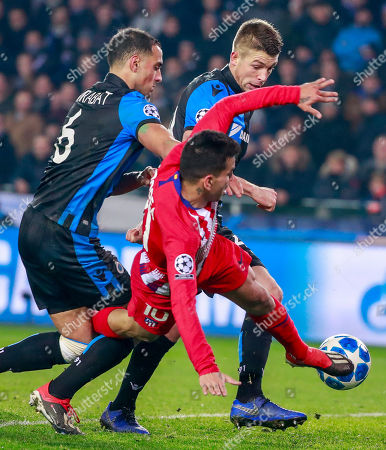 (L-R) Sofyan Amrabat of Club Brugge KV , Angel Correa of Atletico Madrid and Brandon Mechele of Club Brugge KV  fight for the ball during the UEFA Champions League soccer match between Club Brugge KV and Atletico Madrid at the Jan Breydel Stadium in Bruges, Belgium, 11 December 2018.