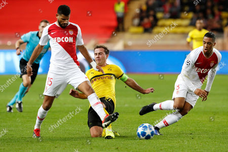 Mario Goetze of Borussia Dortmund (C) in action against Youssef Ait-Bennasser (L) and Youri Tielemans of AS Monaco (R) during the UEFA Champions League Group A soccer match between AS Monaco and Borussia Dortmund, at Stade Louis II, in Monaco, 11  December 2018.