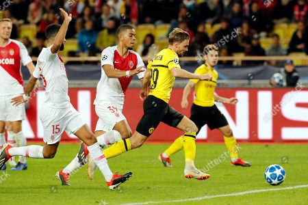 Marcel Schmelzer of Borussia Dortmund (R) in action against Youssef Ait-Bennasser (L) and Benjamin Henrichs of AS Monaco (C) during the UEFA Champions League Group A soccer match between AS Monaco and Borussia Dortmund, at Stade Louis II, in Monaco, 11  December 2018.