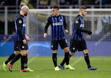 From left, Inter Milan's Borja Valero, Lautaro Martinez and Mauro Icardi leave the pitch at the end of the Champions League, Group B soccer match between Inter Milan and PSV Eindhoven, at the San Siro stadium in Milan, Italy