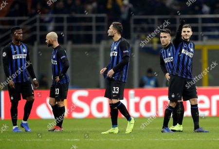 From left, Inter Milan's Keita Balde, Borja Valero, Danilo D'Ambrosio, Lautaro Martinez and Mauro Icardi leave at the end of the Champions League, Group B soccer match between Inter Milan and PSV Eindhoven, at the San Siro stadium in Milan, Italy