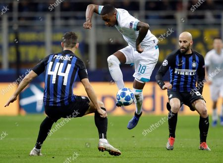 PSV's Pablo Rosario, center, takes on Inter Milan's Ivan Perisic, left, aas Inter's Borja Valero looks, during the Champions League, Group B soccer match between Inter Milan and PSV Eindhoven, at the San Siro stadium in Milan, Italy