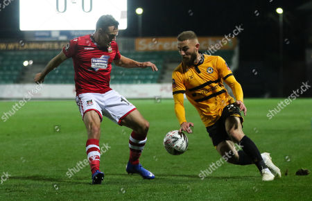 Dan Butler of Newport County takes on Paul Rutherford of Wrexham