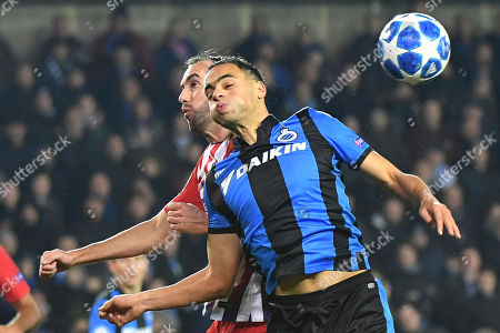 Sofyan Amrabat, Diego Godin. Brugge midfielder Sofyan Amrabat, front, jumps for the ball with Atletico defender Diego Godin during their Champions League group A soccer match between Club Brugge and Atletico Madrid at the Jan Breydel Stadium in Bruges, Belgium