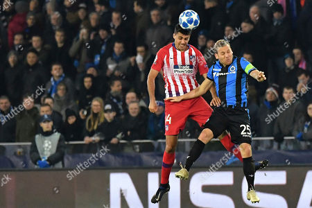 Ruud Vormer, Rodrigo Hernandez. Brugge midfielder Ruud Vormer, right, jumps for the ball with Atletico midfielder Rodrigo Hernandez during their Champions League group A soccer match between Club Brugge and Atletico Madrid at the Jan Breydel Stadium in Bruges, Belgium
