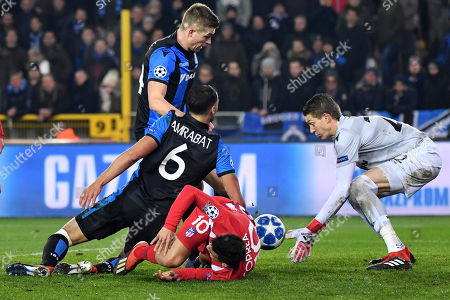 Ethan Horvath, Luan Peres, Sofyan Amrabat, Angel Correa. Brugge goalkeeper Ethan Horvath, right, defender Luan Peres, rear, midfielder Sofyan Amrabat, center, fights for the ball with Atletico forward Angel Correa during their Champions League group A soccer match between Club Brugge and Atletico Madrid at the Jan Breydel Stadium in Bruges, Belgium