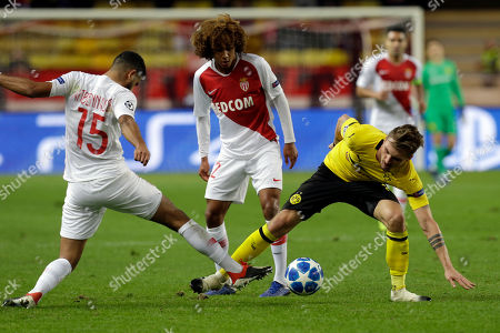 Dortmund's Maximilian Philipp, right, fights for the ball with Monaco midfielder Youssef Ait-Bennasser during the Champions League group A soccer match between AS Monaco and Borussia Dortmund, in Monaco