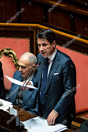 Stock Picture of Italian president of the council Giuseppe Conte reports to the Senate, on the financial maneuver and on the European Council. With him the Minister of European Affairs Paolo Savona. Chamber of the Senate of the Republic.