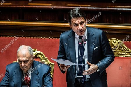 Stock Image of Italian president of the council Giuseppe Conte reports to the Senate, on the financial maneuver and on the European Council. With him the Minister of European Affairs Paolo Savona. Chamber of the Senate of the Republic.