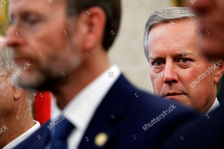 """Rep. Mark Meadows, R-N.C., chairman of the conservative House Freedom Caucus, attends a bill signing by President Donald Trump of H.R. 390, the """"Iraq and Syria Genocide Relief and Accountability Act of 2018,"""" in the Oval Office of the White House, in Washington"""