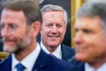 Republican Representative from North Carolina Mark Meadows (C) attends a signing ceremony for H.R. 390, the 'Iraq and Syria Genocide Relief and Accountability Act of 2018', in the Oval Office of the White House in Washington, DC, USA, 11 December 2018. The law will provide emergency humanitarian and recovery assistance to victims of crimes against humanity, war crimes and genocide in Iraq and Syria. The legislation also directs the US State Department to preserve evidence of genocide in those regions.