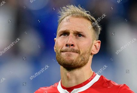 Moscow defender and former Schalke idol Benedikt Hoewedes hides tears in front of Schalke supporters after the Champions League group D soccer match between FC Schalke 04 and Lokomotiv Moscow in Gelsenkirchen, Germany