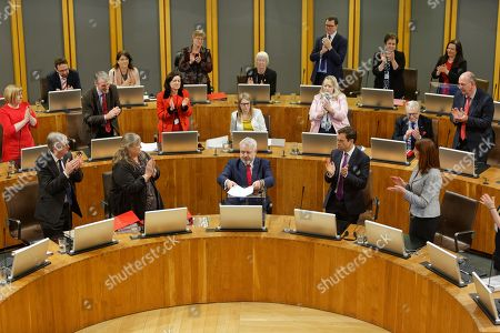 Assdembly Members applaud First Minister for Wales Carwyn Jones (C)