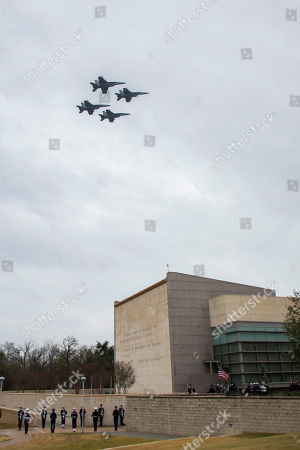 A military flyover crosses over his presidential library as the remains of President George H.W. Bush arrive for internment, in College Station, Texas